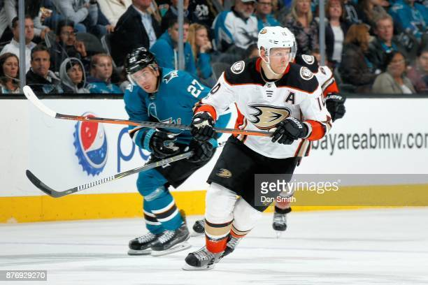 Corey Perry of the Anaheim Ducks skates against Joonas Donskoi of the San Jose Sharks at SAP Center on November 20 2017 in San Jose California