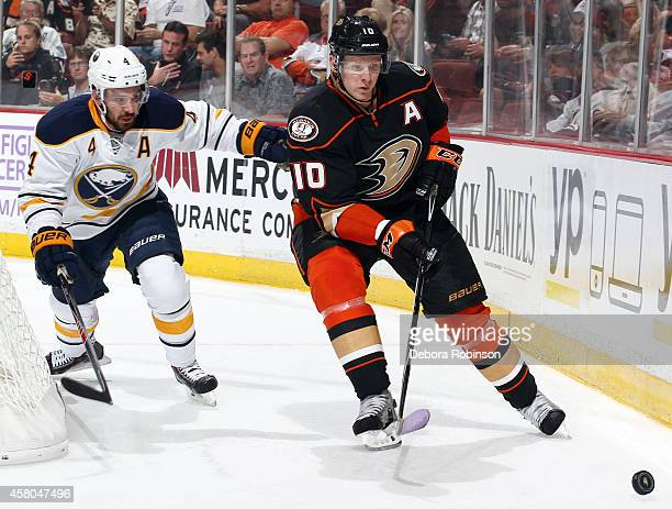 Corey Perry of the Anaheim Ducks skates against Josh Gorges of the Buffalo Sabres on October 22 2014 at Honda Center in Anaheim California