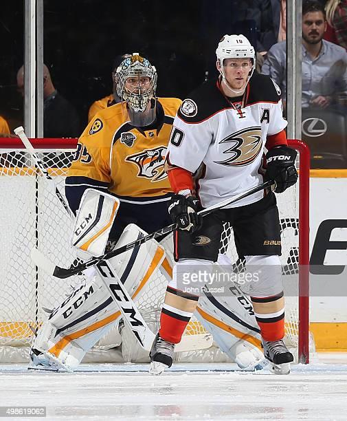 Corey Perry of the Anaheim Ducks skates against Pekka Rinne of the Nashville Predators during an NHL game at Bridgestone Arena on November 17 2015 in...