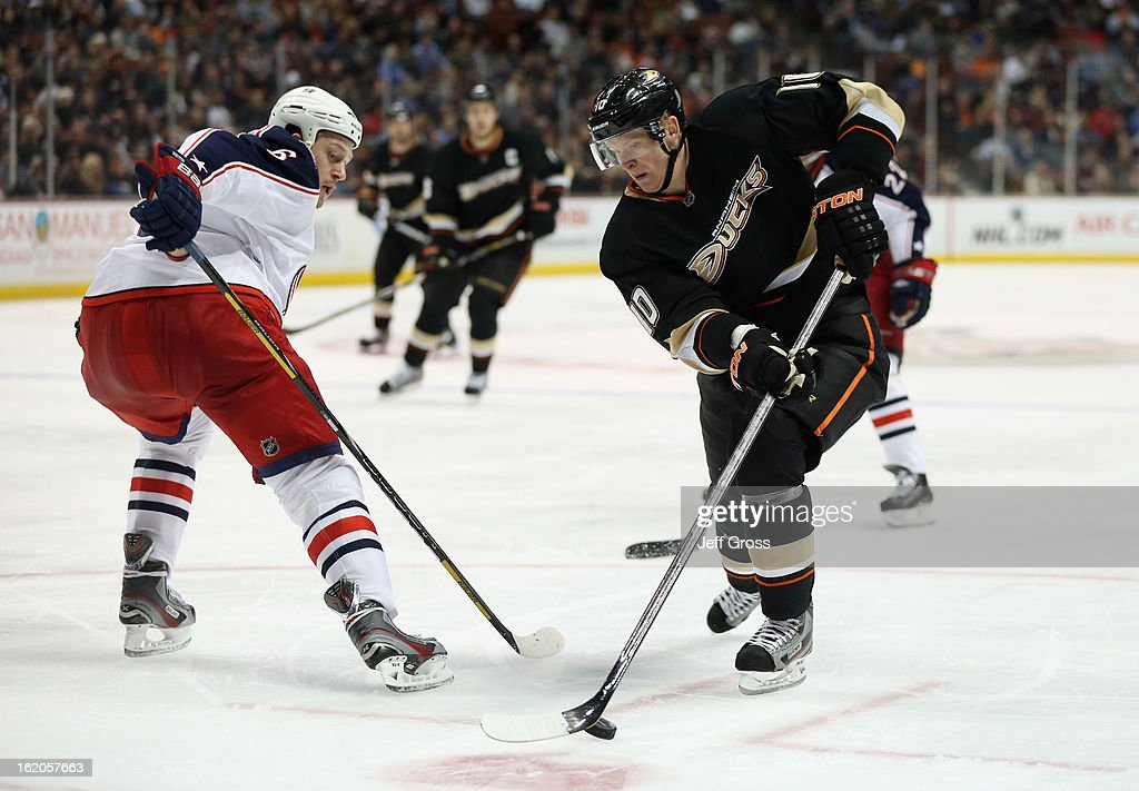 <a gi-track='captionPersonalityLinkClicked' href=/galleries/search?phrase=Corey+Perry&family=editorial&specificpeople=213864 ng-click='$event.stopPropagation()'>Corey Perry</a> #10 of the Anaheim Ducks skates around <a gi-track='captionPersonalityLinkClicked' href=/galleries/search?phrase=Nikita+Nikitin&family=editorial&specificpeople=722107 ng-click='$event.stopPropagation()'>Nikita Nikitin</a> #6 of the Columbus Blue Jackets in the third period at Honda Center on February 18, 2013 in Anaheim, California. The Ducks defeated the Blue Jackets 3-2.