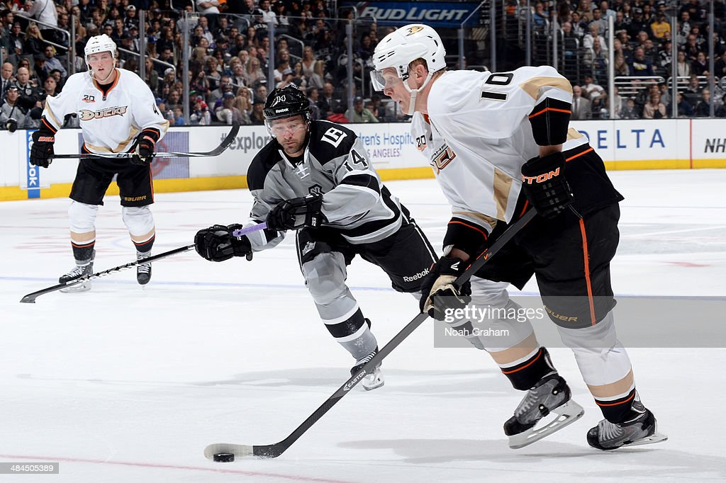 <a gi-track='captionPersonalityLinkClicked' href=/galleries/search?phrase=Corey+Perry&family=editorial&specificpeople=213864 ng-click='$event.stopPropagation()'>Corey Perry</a> #10 of the Anaheim Ducks skates with the puck against Justin Williams #14 of the Los Angeles Kings at Staples Center on April 12, 2014 in Los Angeles, California.