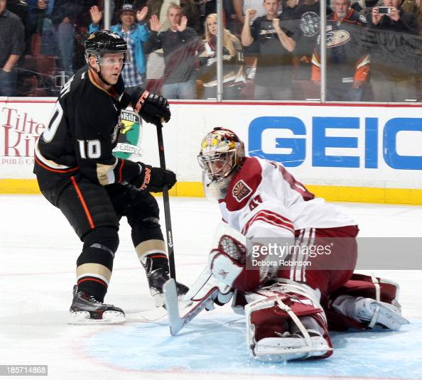 Corey Perry of the Anaheim Ducks takes a shot on goal against Mike Smith of the Phoenix Coyotes on October 18 2013 at Honda Center in Anaheim...