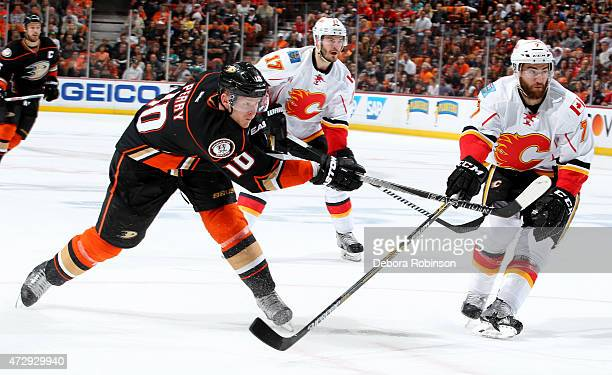 Corey Perry of the Anaheim Ducks takes the slap shot against TJ Brodie of the Calgary Flames in Game Five of the Western Conference Semifinals during...