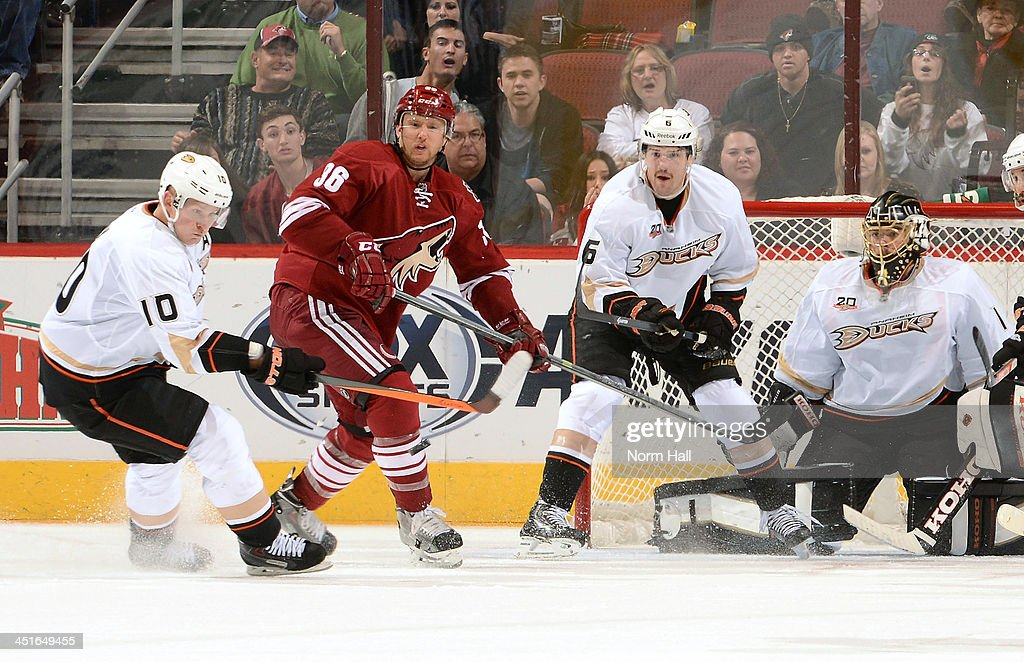 <a gi-track='captionPersonalityLinkClicked' href=/galleries/search?phrase=Corey+Perry&family=editorial&specificpeople=213864 ng-click='$event.stopPropagation()'>Corey Perry</a> #10 of the Anaheim Ducks tries to knock down a shot in front of goaltender Jonas Hiller #1 and defenseman <a gi-track='captionPersonalityLinkClicked' href=/galleries/search?phrase=Ben+Lovejoy&family=editorial&specificpeople=4509565 ng-click='$event.stopPropagation()'>Ben Lovejoy</a> #6 as <a gi-track='captionPersonalityLinkClicked' href=/galleries/search?phrase=Rob+Klinkhammer&family=editorial&specificpeople=2127064 ng-click='$event.stopPropagation()'>Rob Klinkhammer</a> #36 of the Phoenix Coyotes looks to re-direct during the third period at Jobing.com Arena on November 23, 2013 in Glendale, Arizona.