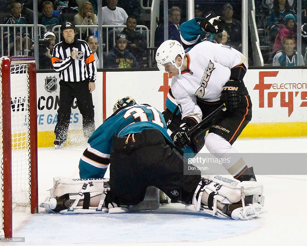 <a gi-track='captionPersonalityLinkClicked' href=/galleries/search?phrase=Corey+Perry&family=editorial&specificpeople=213864 ng-click='$event.stopPropagation()'>Corey Perry</a> #10 of the Anaheim Ducks tries to score against <a gi-track='captionPersonalityLinkClicked' href=/galleries/search?phrase=Antti+Niemi&family=editorial&specificpeople=213913 ng-click='$event.stopPropagation()'>Antti Niemi</a> #31 of the San Jose Sharks during an NHL game on March 27, 2013 at HP Pavilion in San Jose, California.