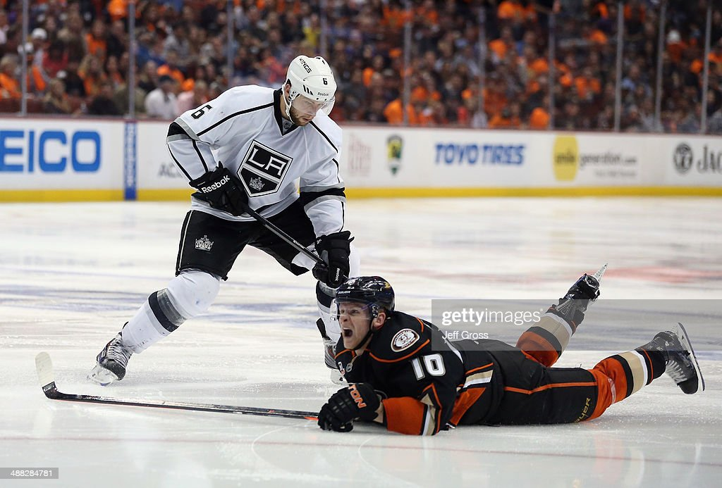 Corey Perry #10 of the Anaheim Ducks winces after being hit by a shot from Jake Muzzin #6 of the Los Angeles Kings in Game One of the Second Round of the 2014 NHL Stanley Cup Playoffs at Honda Center on May 3, 2014 in Anaheim, California.