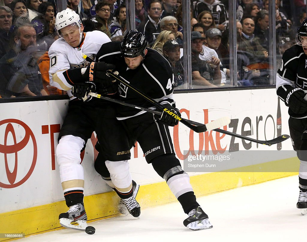 <a gi-track='captionPersonalityLinkClicked' href=/galleries/search?phrase=Corey+Perry&family=editorial&specificpeople=213864 ng-click='$event.stopPropagation()'>Corey Perry</a> #10 ofthe Anaheim Ducks and <a gi-track='captionPersonalityLinkClicked' href=/galleries/search?phrase=Robyn+Regehr&family=editorial&specificpeople=171828 ng-click='$event.stopPropagation()'>Robyn Regehr</a> #44 of the Los Angeles Kings battle for the puck at Staples Center on April 13, 2013 in Los Angeles, California.