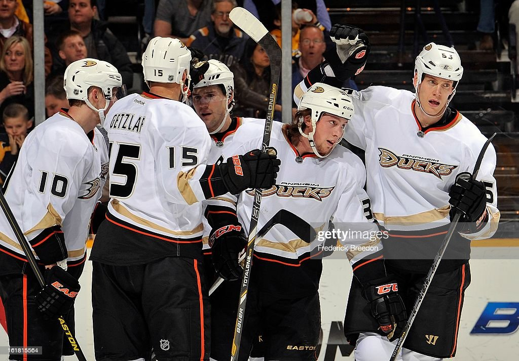 Corey Perry #10, Ryan Getzlaf #15, and Bryan Allen #55 of the Anaheim Ducks congratulate teammate Matt Beleskey #39 on scoring a goal against the Nashville Predators at the Bridgestone Arena on February 16, 2013 in Nashville, Tennessee.