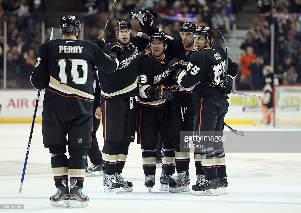 <a gi-track='captionPersonalityLinkClicked' href=/galleries/search?phrase=Corey+Perry&family=editorial&specificpeople=213864 ng-click='$event.stopPropagation()'>Corey Perry</a> #10, <a gi-track='captionPersonalityLinkClicked' href=/galleries/search?phrase=Ryan+Getzlaf&family=editorial&specificpeople=602655 ng-click='$event.stopPropagation()'>Ryan Getzlaf</a> #15, Francois Beauchemin #23, <a gi-track='captionPersonalityLinkClicked' href=/galleries/search?phrase=Sheldon+Souray&family=editorial&specificpeople=203131 ng-click='$event.stopPropagation()'>Sheldon Souray</a> #44 and <a gi-track='captionPersonalityLinkClicked' href=/galleries/search?phrase=Emerson+Etem&family=editorial&specificpeople=6365314 ng-click='$event.stopPropagation()'>Emerson Etem</a> #65 of the Anaheim Ducks celebrate Souray's third period goal against the San Jose Sharks at Honda Center on February 4, 2013 in Anaheim, California. The Ducks defeated the Sharks 2-1.