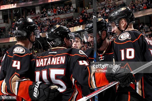 Corey Perry Ryan Kesler and Sami Vatanen of the Anaheim Ducks celebrate Vatanen's third period goal during the game against the Ottawa Senators on...