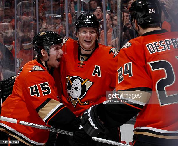 Corey Perry Sami Vatanen and Simon Despres of the Anaheim Ducks celebrate Perry's third period goal and third goal of the game against the Los...