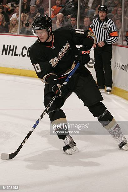 Corey Perry the Anaheim Ducks handles the puck behind the net against the Calgary Flames during the game on February 11 2009 at Honda Center in...
