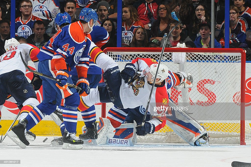 <a gi-track='captionPersonalityLinkClicked' href=/galleries/search?phrase=Corey+Potter&family=editorial&specificpeople=2339200 ng-click='$event.stopPropagation()'>Corey Potter</a> #44 of the Edmonton Oilers battles for position against <a gi-track='captionPersonalityLinkClicked' href=/galleries/search?phrase=Brad+Boyes&family=editorial&specificpeople=275014 ng-click='$event.stopPropagation()'>Brad Boyes</a> #24 of the Florida Panthers on November 21, 2013 at Rexall Place in Edmonton, Alberta, Canada.