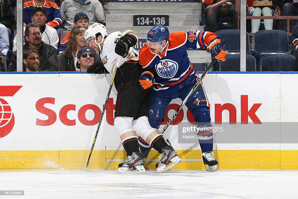 <a gi-track='captionPersonalityLinkClicked' href=/galleries/search?phrase=Corey+Potter&family=editorial&specificpeople=2339200 ng-click='$event.stopPropagation()'>Corey Potter</a> #44 of the Edmonton Oilers checks <a gi-track='captionPersonalityLinkClicked' href=/galleries/search?phrase=Kyle+Palmieri&family=editorial&specificpeople=4783296 ng-click='$event.stopPropagation()'>Kyle Palmieri</a> #51 of the Anaheim Ducks on April 21, 2013 at Rexall Place in Edmonton, Alberta, Canada.