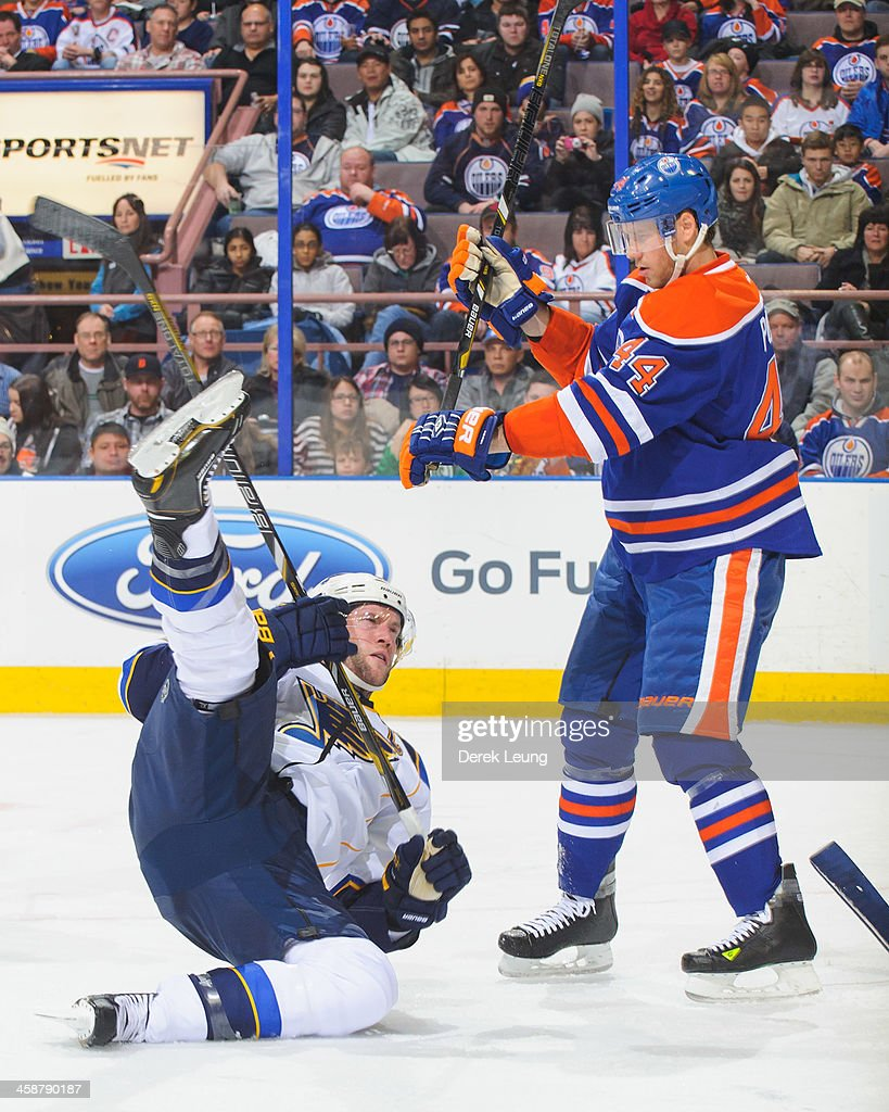 <a gi-track='captionPersonalityLinkClicked' href=/galleries/search?phrase=Corey+Potter&family=editorial&specificpeople=2339200 ng-click='$event.stopPropagation()'>Corey Potter</a> #44 of the Edmonton Oilers knocks <a gi-track='captionPersonalityLinkClicked' href=/galleries/search?phrase=David+Backes&family=editorial&specificpeople=2538492 ng-click='$event.stopPropagation()'>David Backes</a> #42 of the St Louis Blues off his feet during an NHL game at Rexall Place on December 21, 2013 in Edmonton, Alberta, Canada. The Blues defeated the Oilers 6-0.