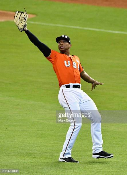 Corey Ray of the Milwaukee Brewers and the US Team fields a ball against the World Team during the SiriusXM AllStar Futures Game at Marlins Park on...
