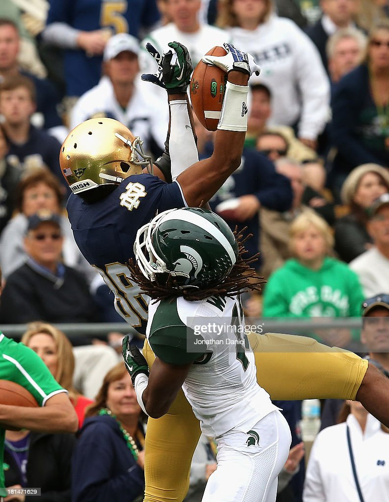 Corey Robinson #88 of the Notre Dame Fighting Irish tries to catch a pass as Trae Waynes #15 of the Michigan State Spartans defends and is called for pass interference at Notre Dame Stadium on September 21, 2013 in South Bend, Indiana.