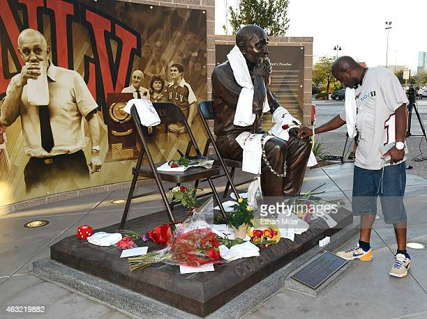 Corey Rossum brother of former UNLV basketball player Clint Rossum pays his respects at a statue of Jerry Tarkanian outside the Thomas Mack Center at...