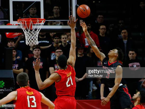 Corey Sanders of the Rutgers Scarlet Knights attempts a shot as Justin Jackson of the Maryland Terrapins defends during the first half of an NCAA...