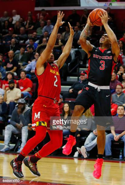 Corey Sanders of the Rutgers Scarlet Knights in action against Melo Trimble of the Maryland Terrapins during an NCAA college basketball game at...