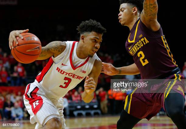 Corey Sanders of the Rutgers Scarlet Knights in action as Nate Mason of the Minnesota Golden Gophers defends during an NCAA college basketball game...