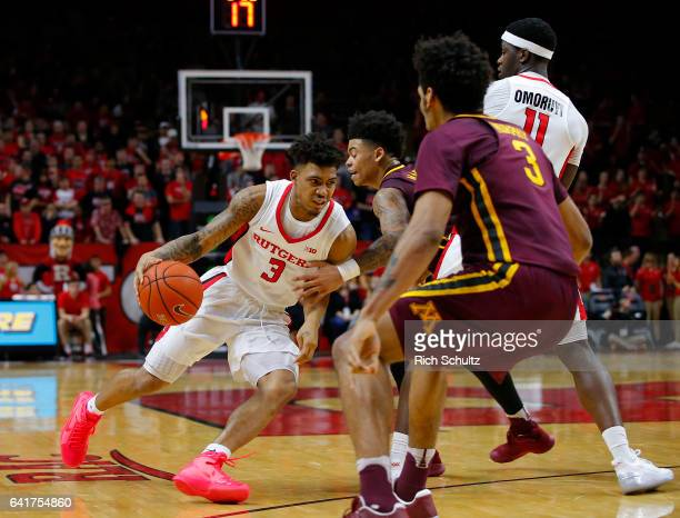 Corey Sanders of the Rutgers Scarlet Knights in action as Nate Mason and Jordan Murphy of the Minnesota Golden Gophers defend during an NCAA college...