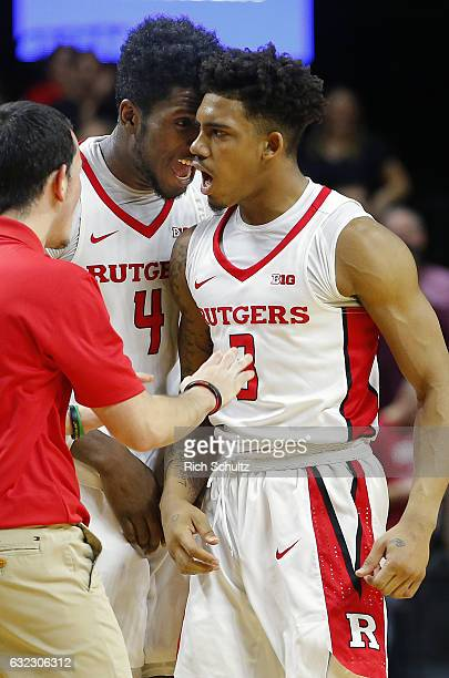 Corey Sanders of the Rutgers Scarlet Knights is congratulated by teammate Jonathan Laurent after Sanders' basket with one second left on the clock...