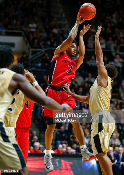 Corey Sanders of the Rutgers Scarlet Knights passes the ball off as Carsen Edwards of the Purdue Boilermakers defends at Mackey Arena on February 14...