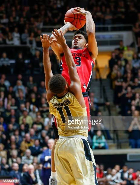 Corey Sanders of the Rutgers Scarlet Knights shoots the ball against PJ Thompson of the Purdue Boilermakers at Mackey Arena on February 14 2017 in...