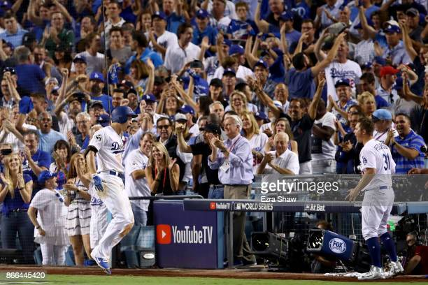Corey Seager of the Los Angeles Dodgers celebrates after hitting a tworun home run during the sixth inning against the Houston Astros in game two of...