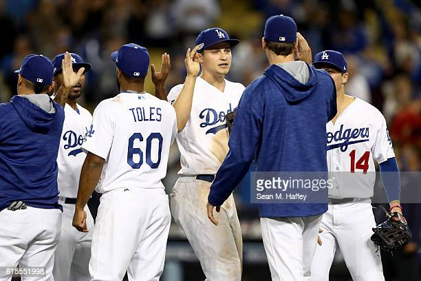 Corey Seager of the Los Angeles Dodgers celebrates the Dodgers 60 win against the Chicago Cubs in game three of the National League Championship...