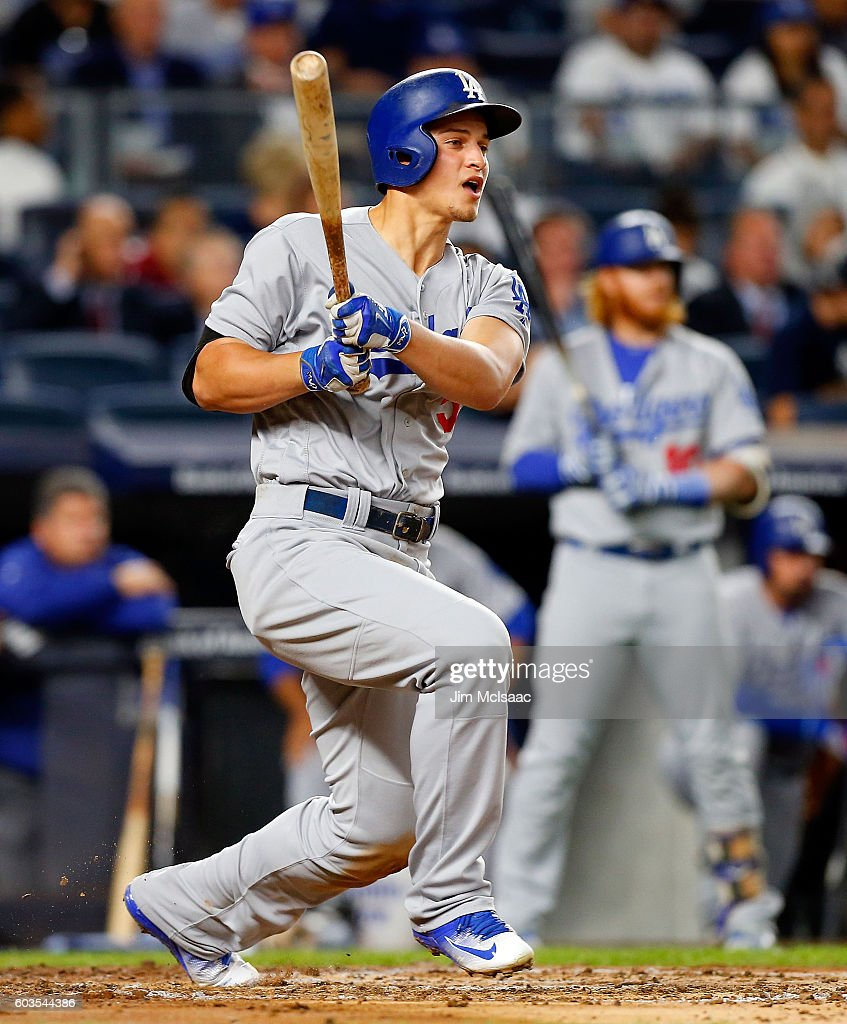 Corey Seager #5 of the Los Angeles Dodgers follows through on a second inning RBI base hit against the New York Yankees at Yankee Stadium on September 12, 2016 in the Bronx borough of New York City.