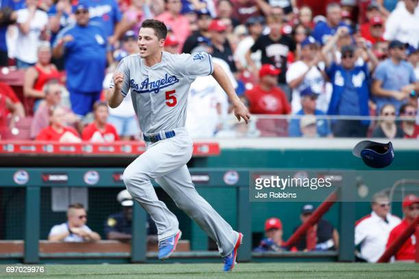 Corey Seager of the Los Angeles Dodgers loses his helmet while coming around to score a run after a double by Chris Taylor in the third inning of a...
