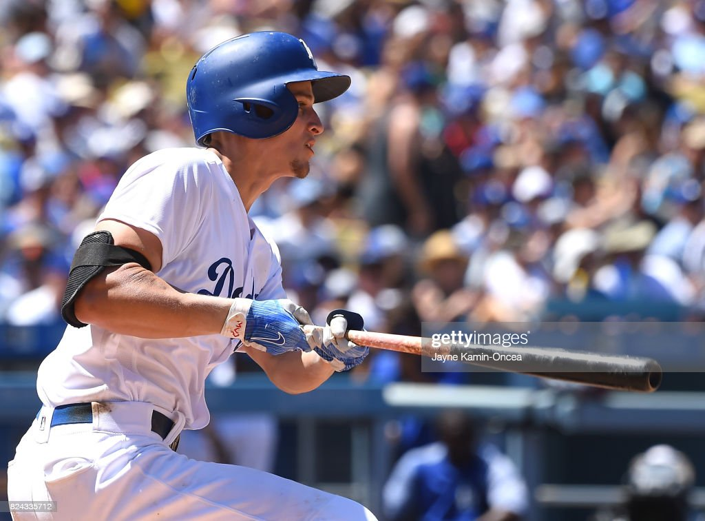 Corey Seager #5 of the Los Angeles Dodgers singles in the sixth inning of the game against the San Francisco Giants at Dodger Stadium on July 29, 2017 in Los Angeles, California.