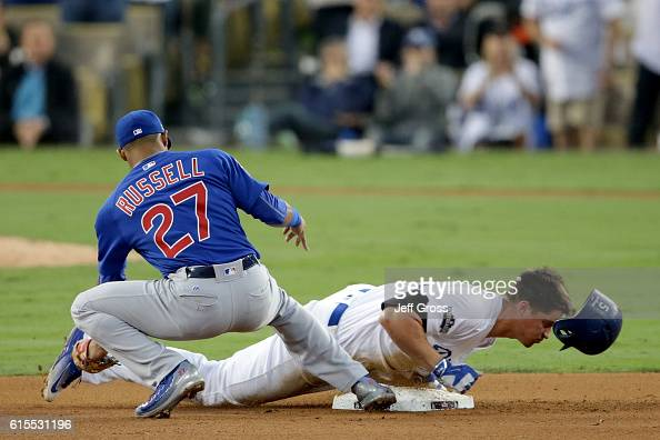 Corey Seager of the Los Angeles Dodgers slides into second base safe after a RBI base hit in the third inning against the Chicago Cubs in game three...