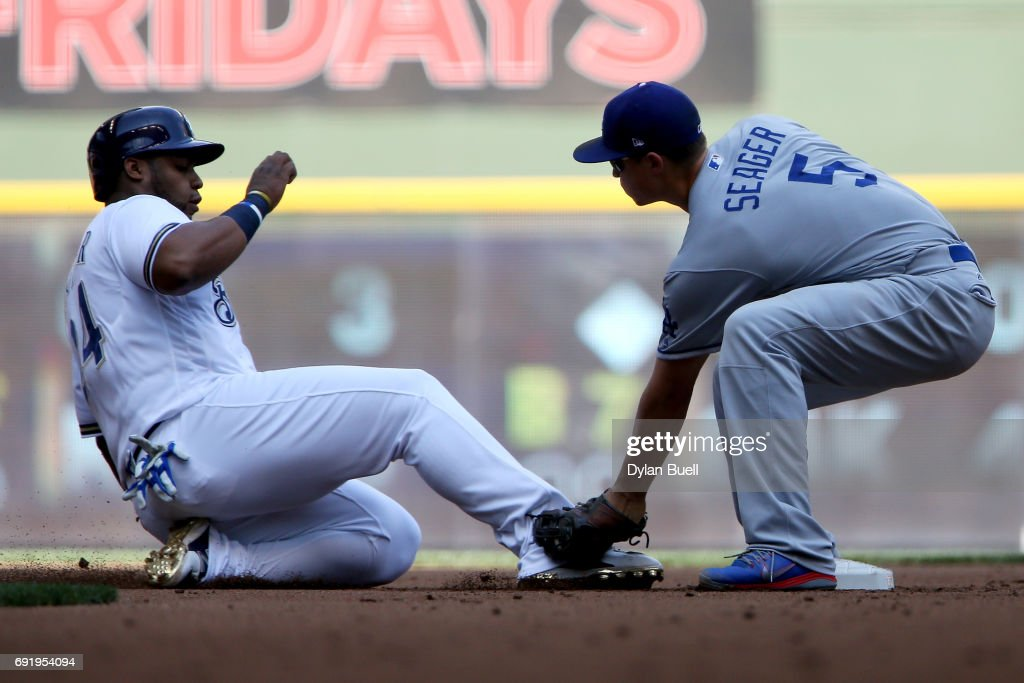 Corey Seager #5 of the Los Angeles Dodgers tags out Jesus Aguilar #24 of the Milwaukee Brewers at second base during a pickoff in the first inning at Miller Park on June 3, 2017 in Milwaukee, Wisconsin.