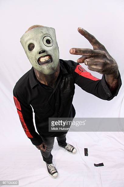 Corey Taylor of Slipknot poses for a studio portrait session flicking the vs at the camera backstage at the Download Festival Donington Park...