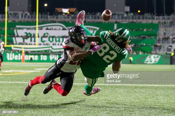 Corey Tindal of the Ottawa Redblacks breaks up a pass in the end zone intended for Naaman Roosevelt of the Saskatchewan Roughriders in the first half...