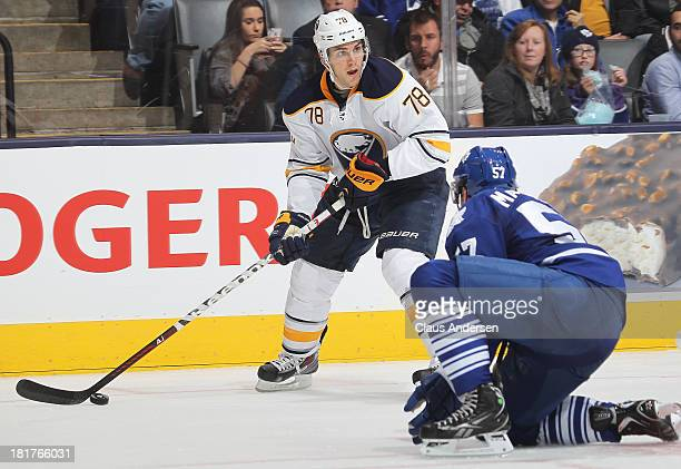 Corey Tropp of the Buffalo Sabres controls the puck in a preseason game against the Toronto Maple Leafs on Sept 22 2013 at the Air Canada Centre in...