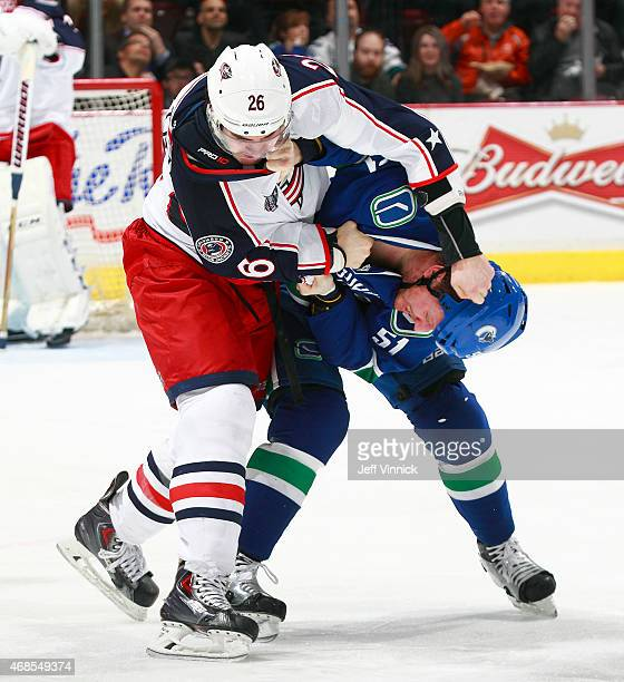 Corey Tropp of the Columbus Blue Jackets and Derek Dorsett of the Vancouver Canucks fight during their NHL game at Rogers Arena March 19 2015 in...