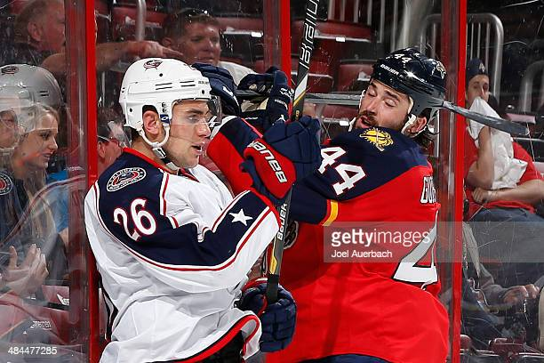Corey Tropp of the Columbus Blue Jackets and Erik Gudbranson of the Florida Panthers come together behind the net during second period action at the...