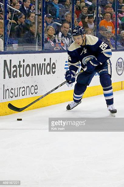 Corey Tropp of the Columbus Blue Jackets controls the puck during the game against the Winnipeg Jets on December 16 2013 at Nationwide Arena in...