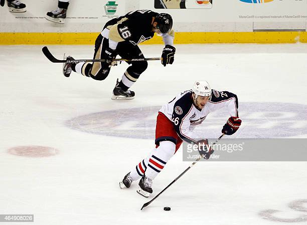 Corey Tropp of the Columbus Blue Jackets handles the puck against Brandon Sutter of the Pittsburgh Penguins during the game at Consol Energy Center...