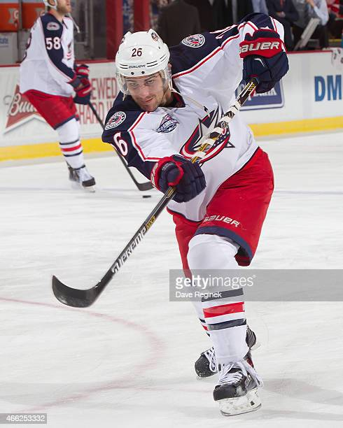 Corey Tropp of the Columbus Blue Jackets shoots the puck in warmups before a NHL game against the Detroit Red Wings on March 12 2015 at Joe Louis...