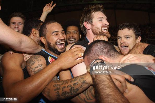 Corey Webster Dillon Boucher and Kirk Penney celebrate with Paul Henare of the Breakers after winning game three of the NBL Grand Final series...