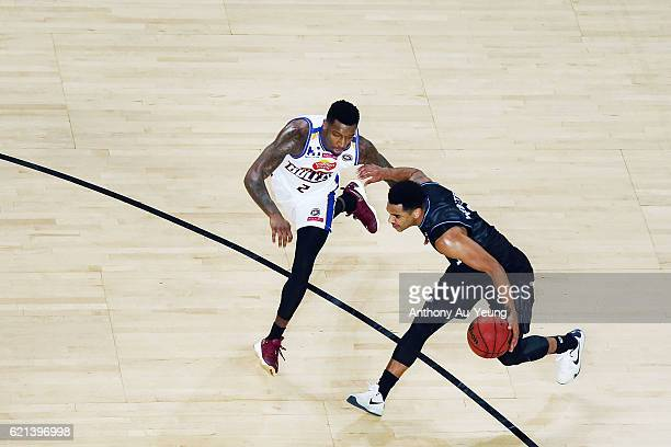 Corey Webster of New Zealand drives against Torrey Craig of Brisbane during the round five NBL match between the New Zealand Breakers and the...