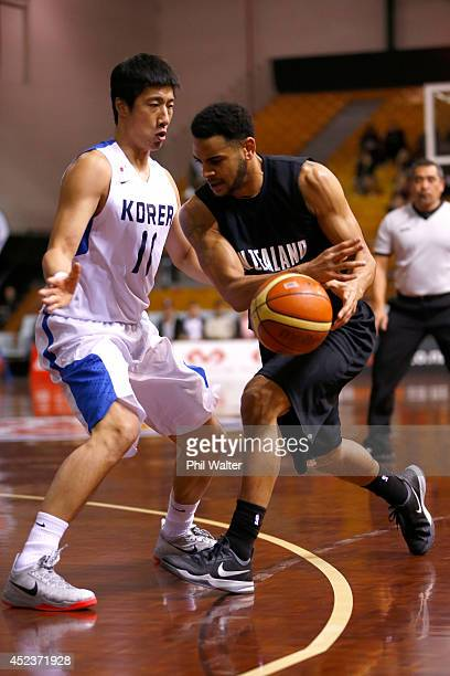Corey Webster of New Zealand runs the ball forward during the international match between the New Zealand Tall Blacks and South Korea at North Shore...