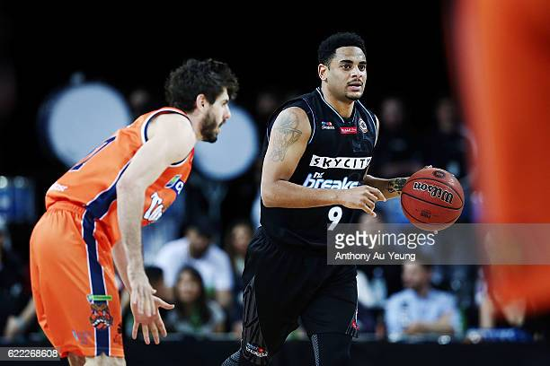 Corey Webster of the Breakers brings the ball up against Jarrad Weeks of the Taipans during the round six NBL match between the New Zealand Breakers...