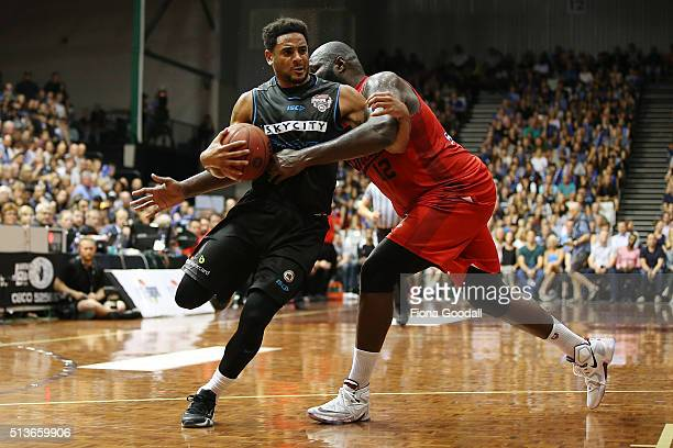 Corey Webster of the Breakers is fouled by Nate Jawai of the Wildcats during game two of the NBL Grand Final series between the New Zealand Breakers...