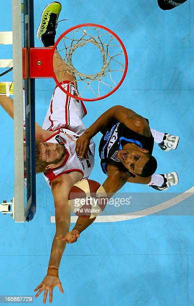 Corey Webster of the Breakers shoots under pressure from Jesse Wagstaff of the Wildcats during game one of the NBL Grand Final series between the New...